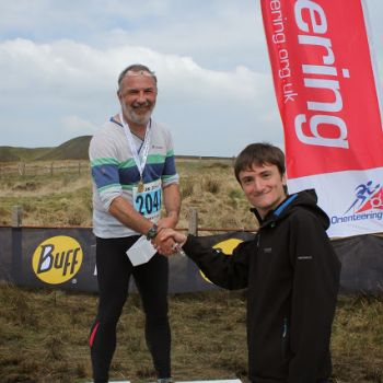 PreO podium - John Kewley, 1st in Elite, Source: