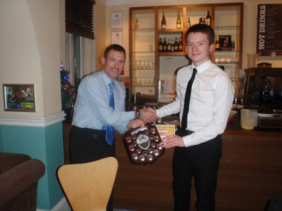 Jon Carberry, NWJS lead coach, presenting Matt with the shield